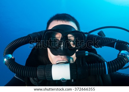 SCUBA diver on a closed circuit rebreather underwater - stock photo