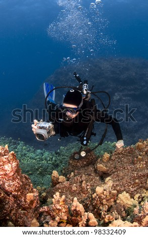 Scuba Diver Photographing the Coral in Hawaii - stock photo