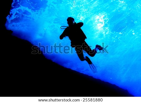 scuba diver silhouette in tropical waters; maui, hawaii