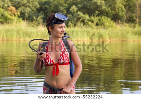 scuba diver young woman summer river - stock photo