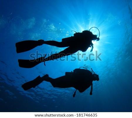 Scuba Diving couple - stock photo