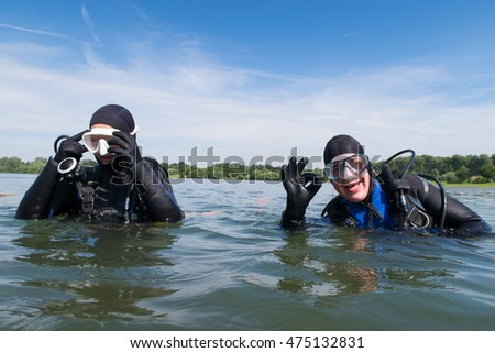 scuba diving course couple open water with diving mask and diving gear Europe diving school diving instruction