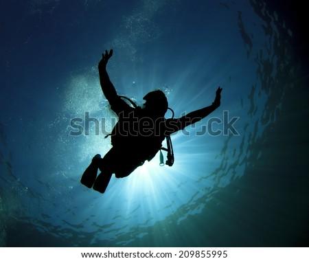 Scuba diving fun - stock photo