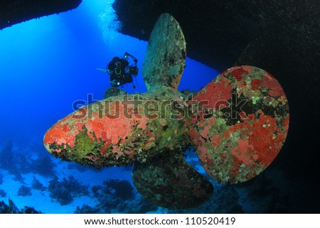 Scuba Diving on a shipwreck - on the propeller of the Salem Express, Red Sea - stock photo