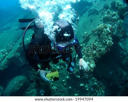 Scuba Diving on a sunken Wharf in Maui Hawaii - stock photo
