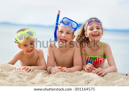 Scuba diving time on the beach - stock photo