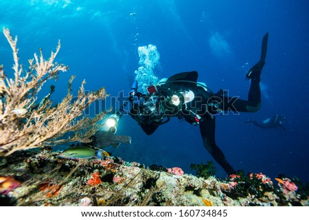 scuba diving with underwater camera