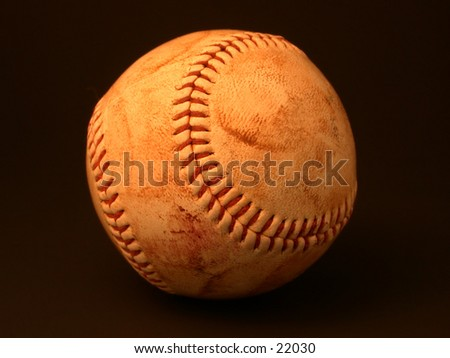 Scuffed, well-used baseball - take me out to the ballgame! - stock photo