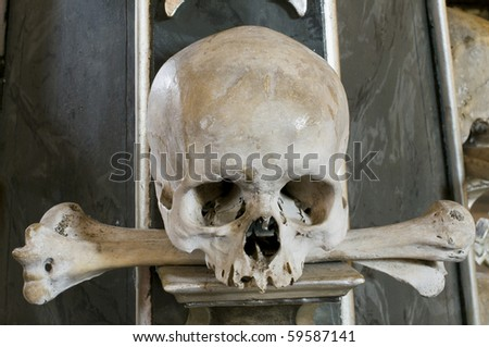 Scull and bones from Bone church (Ossuary, Kostince) in Sedlec, a suburb of Kutna Hora, Czech Republic, a UNESCO world heritage site - stock photo