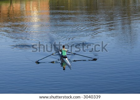 Sculler or rower on River Clyde in evening sunshine, Glasgow - stock photo