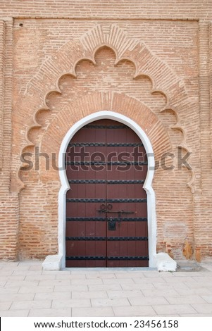 Sculpted Islamic design on the Koutoubia Mosque doorway in Marrakesh - stock photo