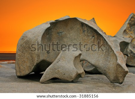 Sculpted rock formation and orange sky at Remarkable Rocks in Flinders Chase National Park, Kangaroo Island, South Australia - stock photo