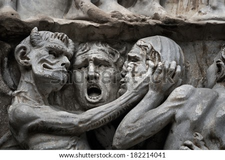 Sculptural group with the image of a devil and sinners on an external facade of the Cathedral, Orvieto, Italy