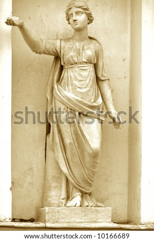 Sculpture ancient greek mythology. One photo from the series. Sepia Tone. - stock photo