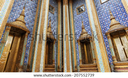 Sculpture decorated Windows and pillars of Thai Temple
