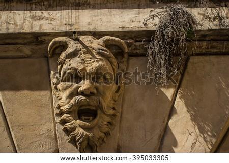 Sculpture face in Bologna - stock photo