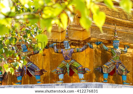 Sculpture in Royal Palace, Bangkok, Thailand. Wat Phra Keo. Architecture detail - statue of mythical creature with blue skin. - stock photo