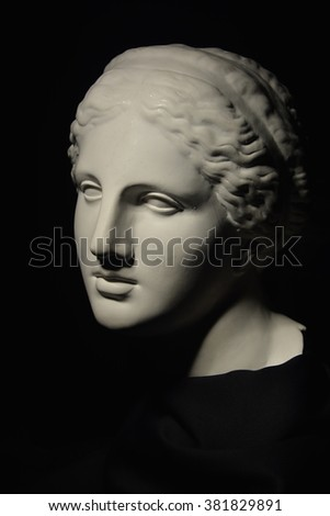 sculpture of a lovely female head on a dark background