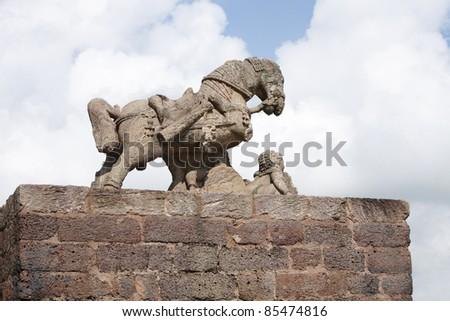 Sculpture of a war horse ruins - stock photo