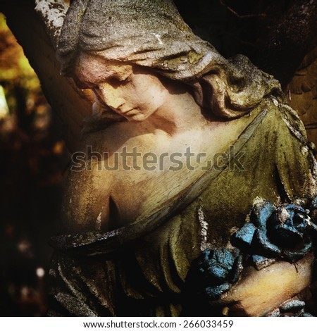 sculpture of an angel with dark background (details) - stock photo