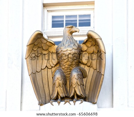 Sculpture of an eagle near a window in Ashland, OR - stock photo