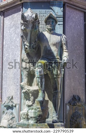 sculpture of an old soldier and his horse - stock photo