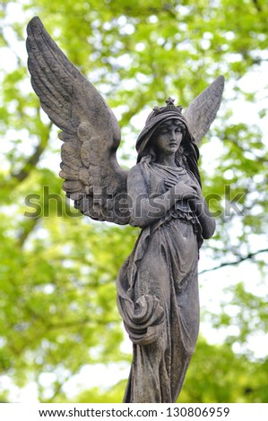 Sculpture of Angel at a old Prague cemetery Vysehrad - stock photo