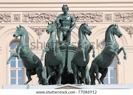 Sculpture of chariots on the facade of the building of The Bolshoi theater in Moscow, built in 1825 - stock photo