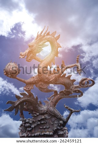 Sculpture of Chinese dragon on blue sky - stock photo