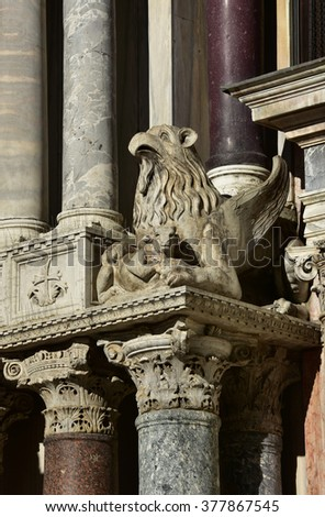 Sculpture of Griffin and ox with byzantine capitals from the southern facade of Saint Mark Basilica, Venice - stock photo