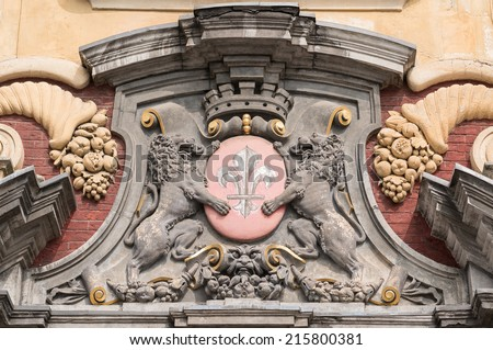 Sculpture of Lills's blazon, coat of arms, with flowers of lily and lions, France - stock photo