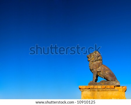 Sculpture of lion on a background dark blue sky - stock photo