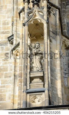 Sculpture of Madonna with Child Jesus on right above Golden Gate of famous St. Vitus cathedral in Prague, Czech Republic. - stock photo