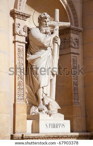 Sculpture of Saint Philipp on wall of St. Mary church at Mosta, Malta - stock photo