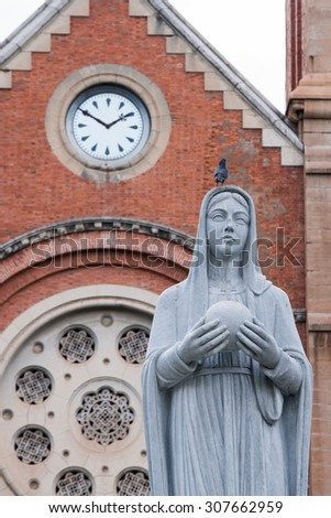 Sculpture of the Virgin Mary in front of the Notre-Dame Saigon Basilica in Ho Chi Minh City, Vietnam - stock photo