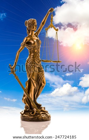 sculpture of themis, femida or justice goddess on outdoors bright blue sky copy space background - stock photo