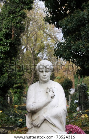 Sculpture of Woman on a old Prague Cemetery, Czech Republic - stock photo
