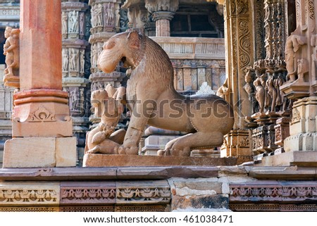 Sculpture of woman with lion at the Kandariya Mahadeva temple in Khajuraho, India. Most Khajuraho temples were built between 950 and 1050 by the Chandela dynasty.