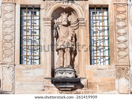 Sculpture on the top of the entrance to Coimbra University in Portugal - stock photo