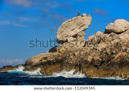 Sculpture on top of a rock at Capri Island, Italy - stock photo