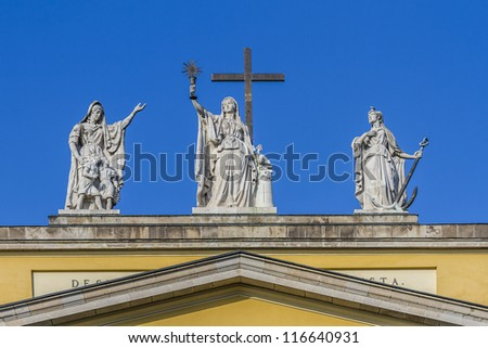 Sculpture on top of the Basilica. The Cathedral or basilica of Eger - this is the third largest Catholic Church in Hungary. It was built between 1831 - 1837 in classicist designs by Joseph Hild. - stock photo