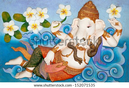 Sculpture sandstone of ganesha isolated on white background. This is traditional and generic style in Thailand. No any trademark or restrict matter in this photo. - stock photo