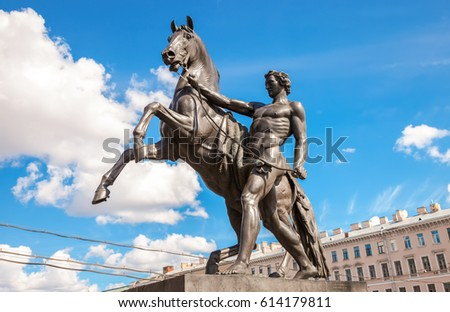 Sculpture tamer of horses, designed by the Russian sculptor Baron Peter Klodt.  Anichkov bridge, St. Petersburg, Russia, 1841