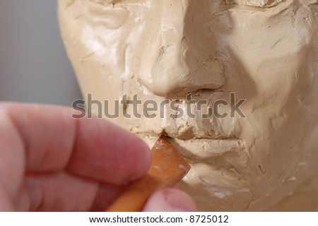 Sculpture work in the studio. Close up. - stock photo