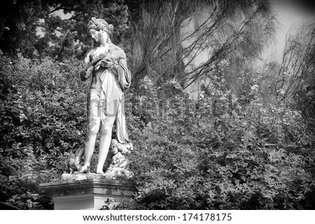 Sculptured figure on the grounds of the Achillion Palace on the island of Corfu. - stock photo