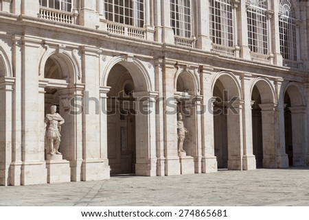 Sculptures and arches of the Royal palace in Madrid, Spain - stock photo