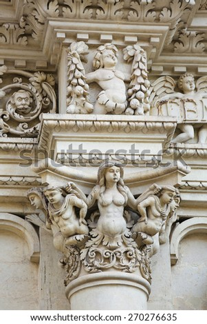 Sculptures at the Basilica of Santa Croce or Church of the Holy Cross is a famous baroque church in Lecce, a historic city in Apulia, Southern Italy.  - stock photo