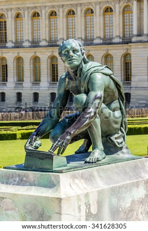 Sculptures in garden of Versailles Palace. Palace Versailles was a royal chateau. It was added to UNESCO list of World Heritage Sites. Versailles, France. - stock photo