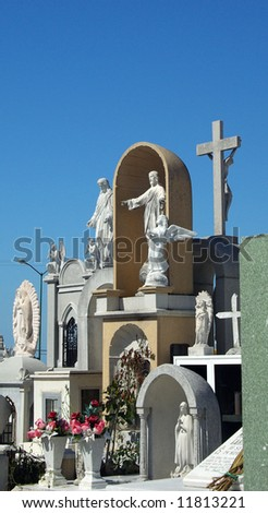 Sculptures in mexican graveyard - stock photo