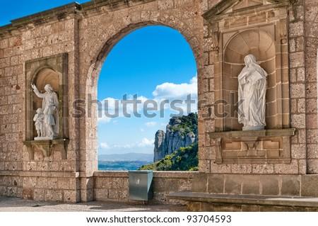 Sculptures in the cloister Montserrat Monastery, Tarragona province, Spain - stock photo